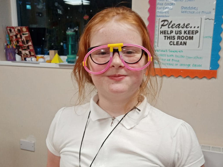 Showing off dayglow glasses